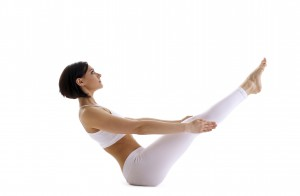 young beauty woman in white lay in yoga asana - fish pose isolated
